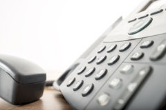 Close up angled view of a black landline telephone with a number Stock Photos