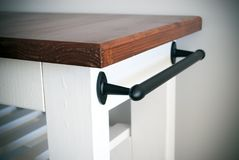 Kitchen island trolley with towel rail stock photography