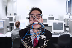 Close-up angry businessman tied in rope and cable. At office Royalty Free Stock Image