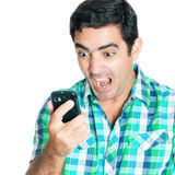 Close-up of an angry man yelling at his mobile phone Stock Photos