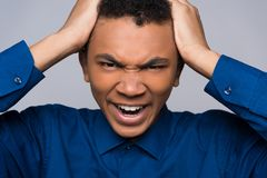 Close up. Annoyed African American teenager Stock Photos