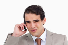 Close up of annoyed salesman on his cellphone Royalty Free Stock Photo