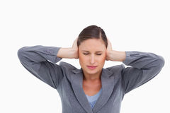 Close up of annoyed tradeswoman covering her ears Stock Image