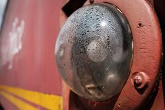 Close-up of an anti-collision light seen on the side of a Royal Mail mobile sorting office. The globe, containing the light shows signs of condensation. The Royalty Free Stock Image
