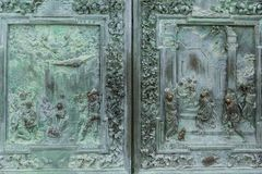 Close up of antique metal high relief and ornament on door,. Pisa, Italy royalty free stock photo