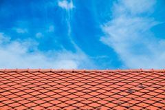 Close up antique red roof. Tile with blue sky Stock Images