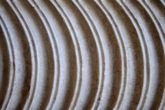 Circular carved pattern in marble wall Stock Photos