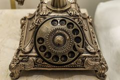 Close up of antique telephone with classical. Close up of antique telephone with classical on table Stock Images