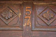 Close Up of antique wooden door number 57 royalty free stock image
