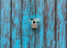 Close up of an antique wooden door painted in blue royalty free stock images