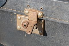 A close up of aold suitcase lock royalty free stock images