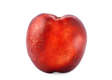 Close-up of an appetizing red nectarine. Ripe peach, isolated on the white background. A whole nutritious fruit, full of vitamins. Stock Image