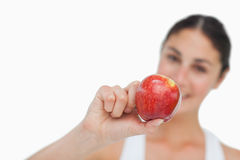 Close-up on a apple holding by a brunette Royalty Free Stock Photography