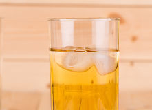 Close up of apple juice with ice. Stock Images