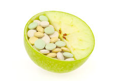 Close up of apple and pills isolated Stock Photos