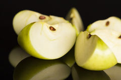 Close up of apple slices on black background. Royalty Free Stock Images
