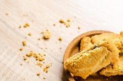 Close up Apple strudel crispy pies on wood background. Stock Photos