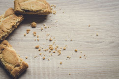 Close up Apple strudel crispy pies on wood background. Royalty Free Stock Photos
