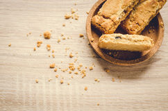 Close up Apple strudel crispy pies on wood background. Royalty Free Stock Images