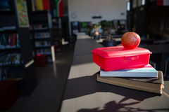 Close up of apple on tiffin box at library Royalty Free Stock Photography