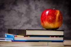 Close-up of Apple on Top of Books Stock Photography