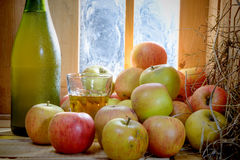 Close up of apples and a bottle of cider Royalty Free Stock Photography