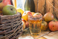 Close up of apples and a glass of cider Stock Photo