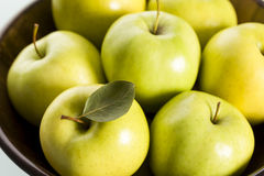 Close up of apples in wooden basket. Royalty Free Stock Photo