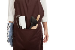 Close up of apron with  cooking and baking ,kitchen  tools Royalty Free Stock Photography