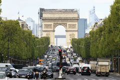 Close up Arc Champs-Elysees. Close-up image of the Arc du Triomphe and  traffic on the Champs-Elysees with La Defense in the background in Paris, France, on Royalty Free Stock Photos