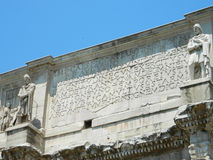 Close-up on the Arch of Constantine in Rome. The Arch of Constantine (Italian: Arco di Costantino) is a triumphal arch in Rome, situated between the Colosseum Royalty Free Stock Photos