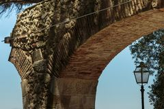 Close-up of Arch Structure and Old Light inside Castle of Sao Jorge in Lisbon, Portugal.  Royalty Free Stock Photo