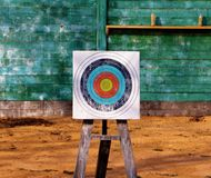 Close up of archery target on green wooden boards background Stock Photo