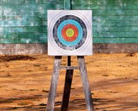 Close up of archery target on green wooden boards background Royalty Free Stock Image