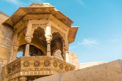 Close up of the arches of a rajasthani palace shot against a blu Stock Images