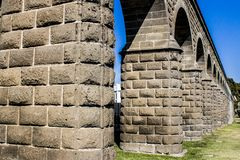 Close up of the arches of a stone aqueduct royalty free stock photos