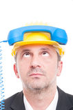 Close-up of architect acting silly with telephone receiver on hi Royalty Free Stock Photo