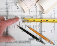 Close up of architect with blueprints Royalty Free Stock Photos