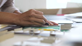 Close Up Of Architect Cutting Out Component For Model