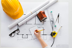 Close up of architect hand with blueprint Royalty Free Stock Photo
