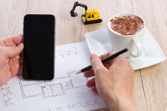 Close-up of architect hands working on a blueprint Royalty Free Stock Photos