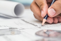 Close-up Of Architect Hands Working On A Blueprint In Office. Bl Stock Image