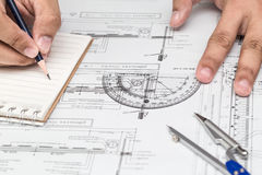 Close-up Of Architect Hands Working On A Blueprint In Office. Bl Stock Photo