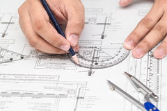 Close-up Of Architect Hands Working On A Blueprint In Office. Bl Royalty Free Stock Photography