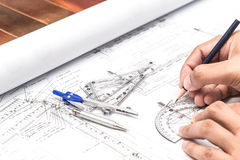 Close-up Of Architect Hands Working On A Blueprint In Office. Bl Stock Photos