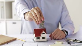 Close up of architect with house keys at office stock video footage