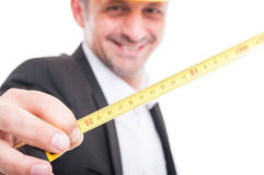 Close-up of architect showing measuring tape. And smiling isolated on white background Royalty Free Stock Images