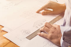 Close up of Architect sketching a construction project stock photos