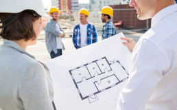 Close up of architects with blueprint at building Royalty Free Stock Photo