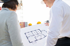 Close up of architects with blueprint at building Royalty Free Stock Photos